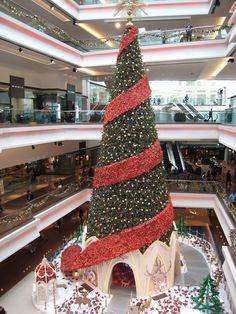 Huge christmas tree at the festival walk shopping mall at kowloon tong, hong kong.