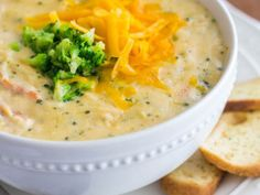 Broccoli cheese soup: ½ medium chopped onion 1 head broccoli, about 2 cups, chopped 1 cup evaporated milk or regular milk 3 cups chicken stock (bouillon cubes ok) 1/2 c. cream cheese 1/4 c. plain yogurt 3 T. cornstarch dissolved in water 8 ounces grated sharp cheddar cheese garlic salt and pepper to taste