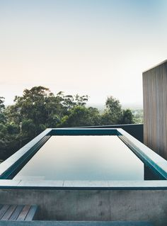 This Australian Abode Is a Glass Pavilion Wrapped in Sliding Hardwood Screens - Photo 10 of 11 - In addition to the pool, there is even a small orchard and terraced vegetable garden.