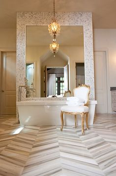 the floor tiled in herringbone design, grey-silver-white, white gold and crystal accents