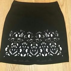 """Skirt Black skirt with white underlings and lining, the top material has a cut out pattern that shows the white underlings, there's also the regular lining in the skirt, the skirt has two pockets and is 21"""" in length Worthington Skirts"""