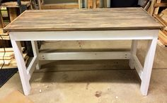 This beautiful handmade desk would look great in any home with any style of decor. It has a white base with a faux reclaimed/barn wood