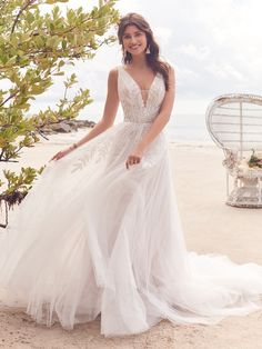 Jenessa, by Rebecca Ingram, is a nature-inspired tulle wedding dress with a plunging V-neckline. Jenessa is the perfect gown for your summer nuptials or sunny destination wedding. Jenessa is available at the Atlas Bridal Shop. Atlas Bridal Shop is a bridal & wedding dress shop in Toledo, Ohio. Dress designers include Morilee, Allure Bridal, Allure Couture, Maggie Sottero, Rebecca Ingram, Sottero Midgely, Jade, Jade Couture, Cameron Blake, Montage, MGNY and more. Top Wedding Dresses, Wedding Dress Pictures, Cute Wedding Dress, Tulle Wedding, Boho Wedding, Bridal Dresses, Wedding Gowns, Wedding Ideas, Destination Wedding