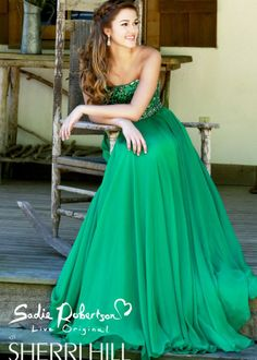 Dance the night away in this gorgeous evening gown that has a strapless sweetheart neckline, a scalloped beaded bust and a long chiffon skirt. This dress is part of the new Sadie Robertson Live Original by Sherri Hill collection for Prom 2014.