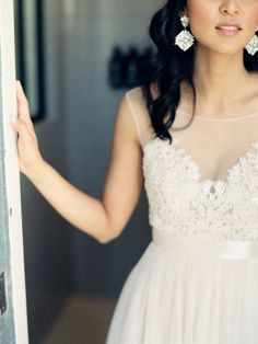 Beautiful lace wedding dress by Watters Brides accented by incredible chandelier earings  Photography: Ashley Kelemen - ashleykelemen.com/  View entire slideshow: Top Dresses of 2014 on http://www.stylemepretty.com/collection/906/