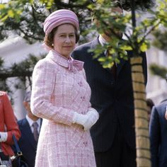 Royal duties: Pictured on May 5, 1975, the Queen stands near an oak sapling, which she pla...