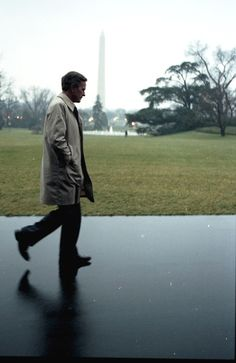 President Bush as he walks by himself outside the White House in front of the Washington Monument, January 16, 1991