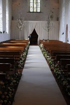 Church Decor/ Flowers and the base of the pew