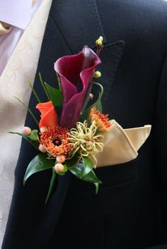"Buttonhole was designed specifically for him, the Grevillea ""Spider Man"" was an essential ingredient, the Schwartzwalder Calla Lily and Rolled Naranga Rose Petal"