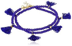 Wrap bracelet with blue-crystal stones featuring gold-tone accents and blue tassels, Lobster-claw clasp.