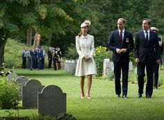 Catherine, Duchess of Cambridge, Prince William, Duke of Cambridge and Prime Minister David Cameron walk through war graves at St Symphorien Military Cemetery on August 4, 2014 in Mons, Belgium