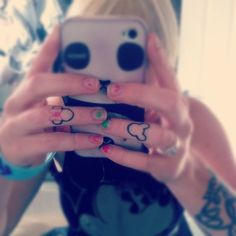 """""""These are my lovely Mickey Mouse and Minnie Mouse tattoos. These, obviously, represent my love for Disney. I am Disney obsessed, and am starting a leg sleeve with lots of Disney characters. But my finger tattoos, are probably my favorite. Cute. Simple. Straight to the point :)"""""""