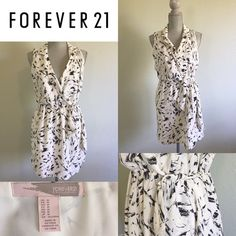 Forever 21 NWOT Wrap Dress Contemporary Abstract Black&White Wrap Dress NWOT. It's true to fit and the material is really light and perfect to use from a day at the office to wearing it out for some drinks. Just slip a cardigan or colorful blazer over it:) Forever 21 Dresses Mini