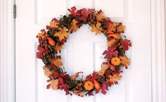 This autumn wreath uses the color palette and themes of the season to bring the outdoors in and  on your door or wall. Click through for the simple tutorial.