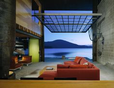 """""""Chicken Point Cabin"""": A 20'x30' overhead window wall opens up the living area to views of Lake Hayden beyond. The mechanics of the window offer a beautiful counterpoint to streamlined forms throughout the rest of the cabin; Hayden Lake, Idaho 