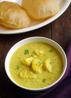 Dahi Aloo recipe - quick and easy Rajasthani style potatoes in a spiced yogurt gravy. It goes well as a side dish for deep fried Indian puffed breads (poori) and flat breads.