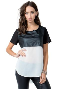 BOUTIQUE FIVE A unique mixed media tee, featuring a black faux leather yoke, white chiffon body with an extended U hem, and short black chiffon sleeves. Single chest pocket. Round neck with chiffon trim. Short zip closure at back. Loose fit. Finished ends. $25.90