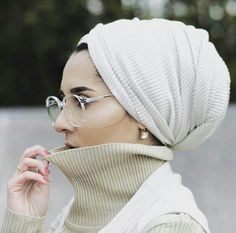 Dina Tokio. (Wether it's a hijab, tichel, or a shaytl many women cover up for modesty purposes. Mostly to please God, themselves, and honor their beauty. I like to see it as a crown that only those who are worthy can see the queen)