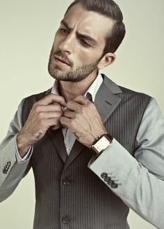 contrast, angled buttonholes on sleeve