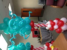Dr. Seuss - Cat in the Hat balloon columns I made for Dr. Seuss Carnival at the kids school. Dr. Seuss Party!