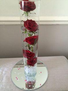 Red Rose Centrepiece   www.facebook.com/entirelybridal