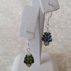 Gorgeous sparkly earrings with Swarovski crystal elements including daisy beads, bicones and cubes to create a Christmas tree shape, these are in
