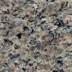 New Caledonia granite - our kitchen, so I don't forget the name of it (again!). Overall grey, with flecks of black and hints of taupe.