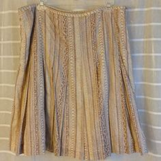 Bream and brown skirt Cute skirt with box pleats. Cotton and fully lined with polyester. 23 inches long, Waist 36 inches. Excellent condition. Jones Wear Skirts A-Line or Full