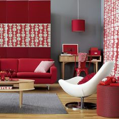 Bold modern living room Grey walls and accents tone down bold red furniture and homeware, giving this living room a sophisticated finish. Retro-print fabric makes a unique artwork when used as panels on the walls.