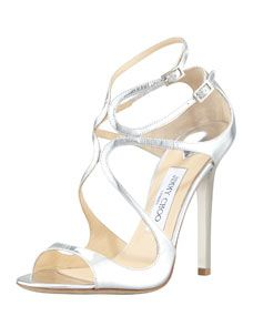 """Metallic leather upper. 4"""" mirror patent covered heel. Loop-strapped upper with buckled ankle straps. Open toe. Leather lining and sole. """"Lang"""" is made in Italy."""