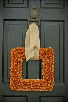 Loving the square wreath concept; unique.  The simplicity of this one would work equally as well for the interior of the home.  Pretty.
