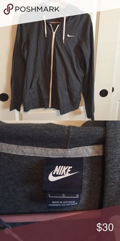 Nike Zip up hoodie size large Grey Nike zip up hoodie. Size large . Barely worn because it was to big Nike Jackets & Coats
