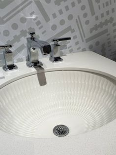 Textured, instead of traditionally smooth, materials are also now a frequent option and add movement and dimension to surfaces. If you want something different, but are afraid of color, try a white tile with a 3D finish. It's subtle enough to make them easy to clean but they still hold interest and drama. Above, Kohler's Derring Collection has sinks with a slight feel around the bowls.