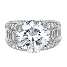 Cartier Diamond Engagement Ring | From a unique collection of vintage engagement rings at http://www.1stdibs.com/jewelry/rings/engagement-rings/
