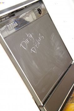 Chalkboard contact paper for an ugly dishwasher facelift! Easy to apply and remove! Perfect for rentals.