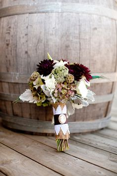 Cute burlap and lace wrap, love the dark colors in the bouquet