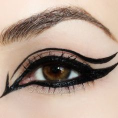 Graphic black eyeliner design ...I'd do it for a crazy night out.