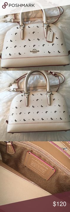 Coach Sierra Satchel Super fun purse that can also be crossbody. Never worn and has red on edges of hem for a nice tough of color. And super cute small cutout butterflies Coach Bags