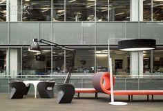 Ron Arad's chairs and table and Bartoli Design's bench gather near lamps by Jac Jacobsen and Kirt Martin in the atrium lounge at Corus Entertainment. Photo by Ben Rahn/A-Frame.