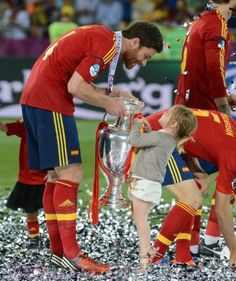 Xabi Alonso and his daughter, Ane, have a trophy tug of war.