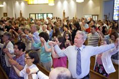 As one parish closes, another community opens its arms. View a #slideshow from the harmonious joining Mass of St. Joseph and Holy Apostles.