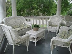 wicker... we have most of this furniture...would love a back porch like this too... sweetness :)
