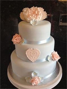 Decorated with pink sugar roses and heart lace panel