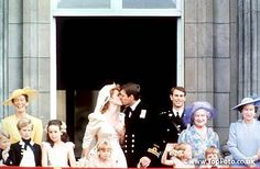 The wedding of Prince Andrew and Sarah Ferguson - kissing on the balcony of Buckingham Palace after the ceremony - 23rd July 1986