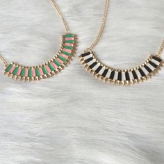 """Mini bib necklace Mini bib necklace. Brand new with tags. Clasp closure. Bottom portion is 3"""" long                       Price is firm unless bundled. No trades                                                                    AVAILABILITY- BLACK/ WHITE: 4 • PINK/ GREEN: 4                                                              All jewelry gets a great discount when bundled!! Boutique Jewelry Necklaces"""
