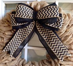 Brighten up your home with this Burlap Wreath. Great for any room in your home or as a display on your front or back door. Could definitely be used all year long as a greeting to all friends and family who come over.    Made of a wire frame base, 40 yards of 5 1/2 inch burlap ribbon, and finished with a layered black burlap and black chevron bow. Colors can be interchanged. Please note in the comment box at the time of purchase your color choices. Pictures of interchanging bows are comin...