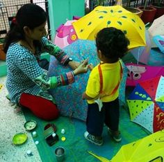 Play is the serious learning of childhood.  A little boy painting the umbrella is just so adorable!  #UmbrellaArt #Creativity #EarlyChildhoodEducation #BestPreschool #Preschool #PicOfTheDay #Preschool #AsiasLargest #EarlyEducation #India