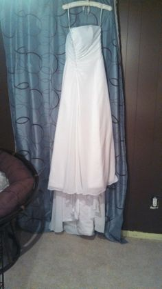 This beautiful dress has never been worn. It was bought by my friend who never ended up getting married. So I bought it from her to help her out. Now that I am getting married, I found another dress and I am looking to sell this one. I paid over $200 for it and all the accessories. It comes with two shawls, a veil and a purse. It is a size 2. Located in Grand Rapids, MI.