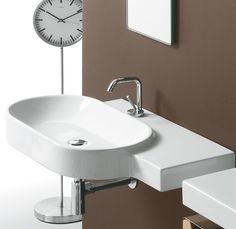 FL23 | Flow Ceramica Simas Oval wall hung washbasin 88 with right shelf pre-punched for single tap hole.