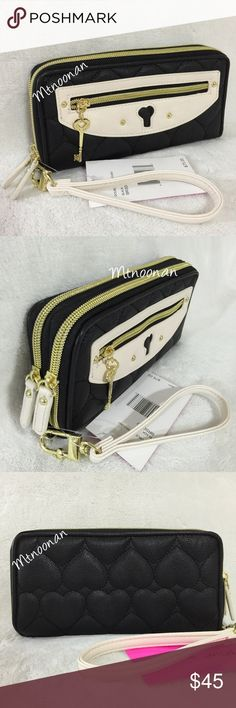 """Betsey Johnson Double Zip Wallet with Wrist Strap Betsey Johnson Large Double Zip Around Wallet with Removable Wrist Strap  • Color: Black / Bone • Dimensions: 8"""" W x 4"""" H x 1.5"""" • Front zip around section: 5 full length slip pockets, 5 card slots & an ID compartment  • Back zip around section: 1 zipper compartment, 2 full length slip pockets and 2 expandable sections that can easily fit PLUS sized cell phones • Exterior: 1 zipper pocket • Metallic gold & pink signature satin lining  ❌ NO…"""